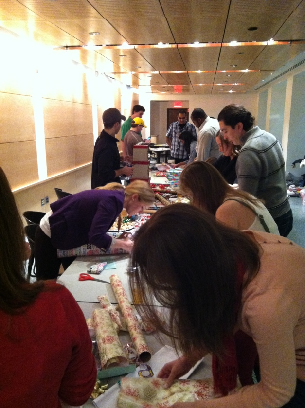 Kellogg Students Wrapping Presents for the Gift Drive