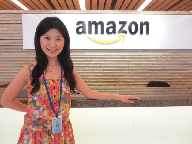Emi Yokoshima '14 in front of the Amazon sign during her summer internship at Amazon Japan