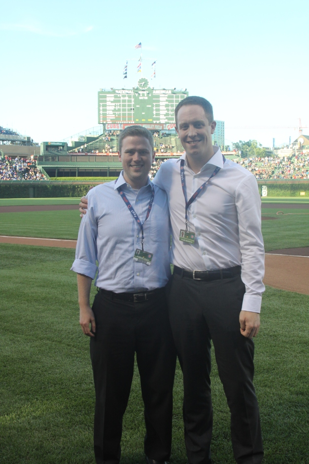 Tyler Barrack '14 and fellow Kellogg student Edmund Rucci '14 on Wrigley Field before a game