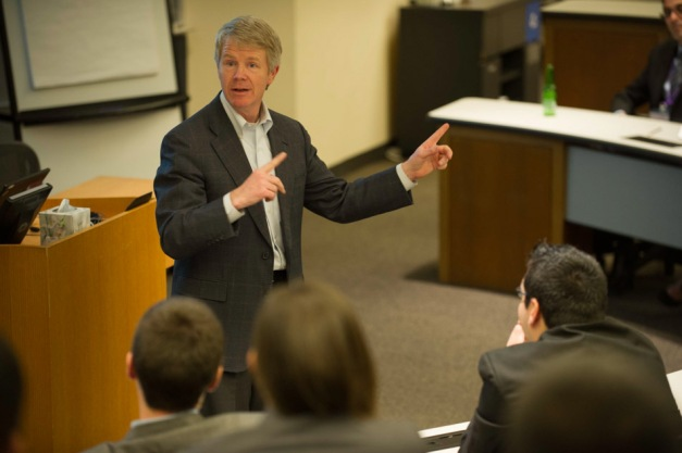 Kellogg Professor Tim Calkins talks to student participants during competition.