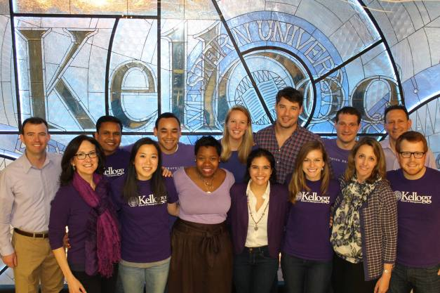 Dean Sally Blount '92, Dean of Students Betsy Ziegler and students gather for a photo in celebration of #NUPurpleFriday.